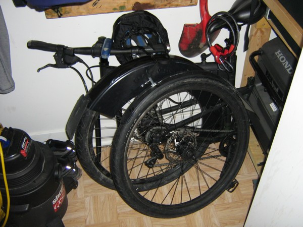Bicycle folded in closet.